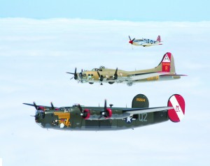 B-24 Liberator, B-17 Flying Fortress and P-51 Mustang in formation.