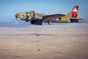 """B-17 """"Nine o Nine"""" over target."""